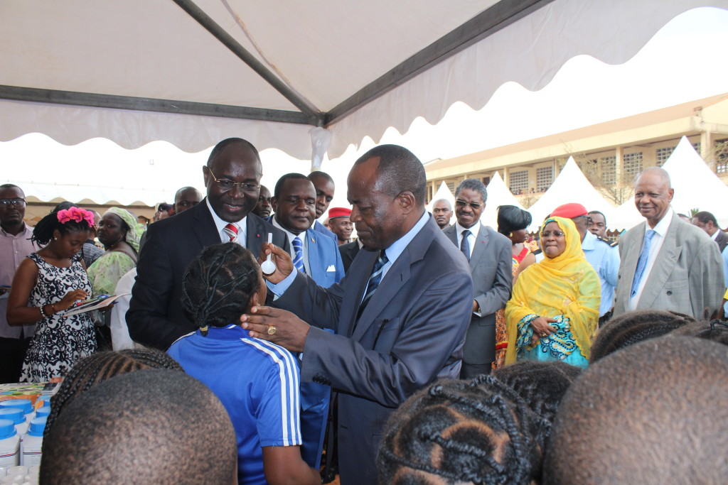 The WHO representative to Cameroon deworming a school girl