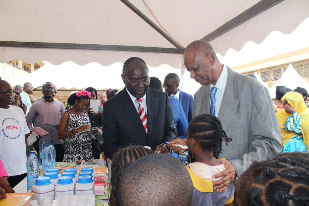 The Secretary of Stafe for Public hEalth deworming a school girl