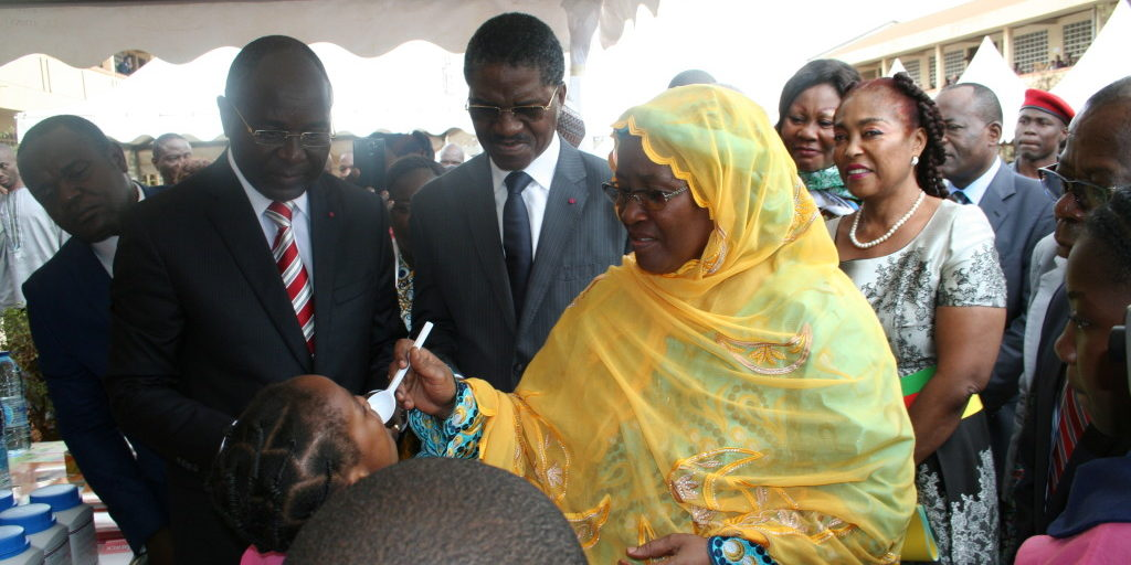 Minister of Basic Education deworming a school girl
